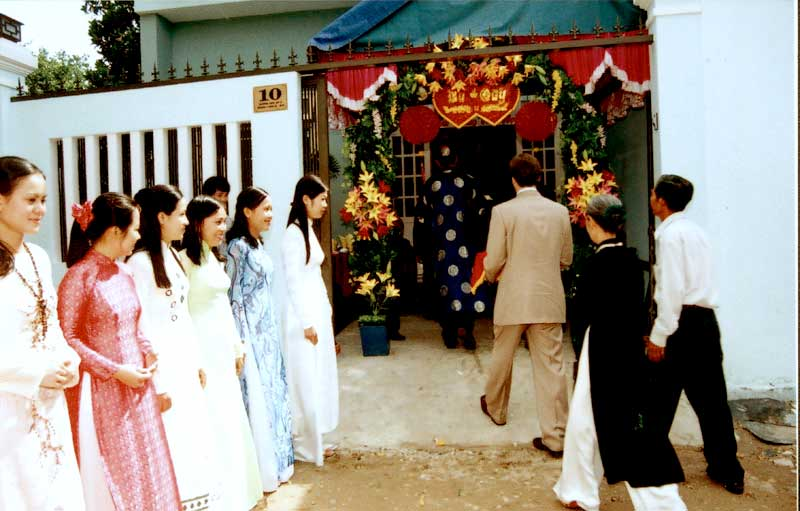 We're greeted by the bride's friends and family wearing beautiful ao dai.